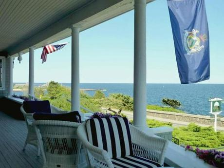 The porch at the Cape Arundel Inn in Kennebunkport, Maine overlooks the ocean by Walker's Point.