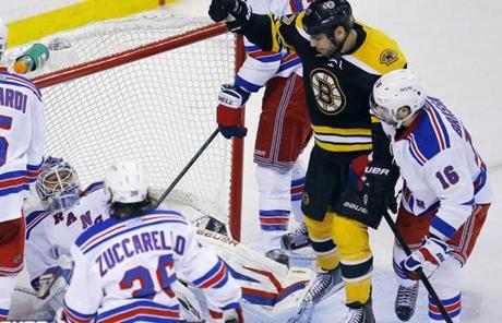 Milan Lucic celebrated after the Bruins scored the game's first goal in the second period