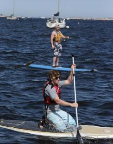 Plum Island guide Jim Conway, 19, top, and Sam Taylor,  front foreground, on stand-up paddleboards.