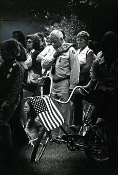 May 26, 1975: A veteran reflected during Amvets Memorial Day services at Fens Stadium. A parade was held leaving from Copley Square and marched along Huntington, Massachusetts, and Westland avenues to the Fens Stadium where these memorial services were held. Darkening the edges of a scene to enhance the subject was a darkroom printing technique often used in the past.