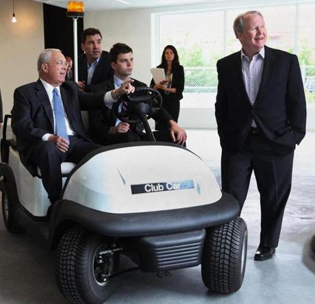 Mayor Thomas M. Menino toured District Hall with (from left) Venture Cafe Foundation CEO Tim Rowe, driver Conor LeBlanc, and Brian Dacey of Venture Cafe Foundation.