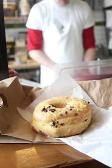 Dough's passion fruit glazed doughnut with cocoa nibs.