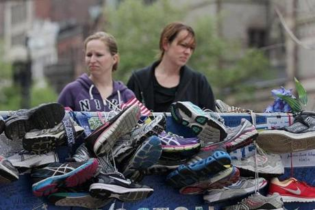 Joy McKinnis and Katrina Ingham of West Richland, Wash., visited the Marathon Memorial in Copley Square.