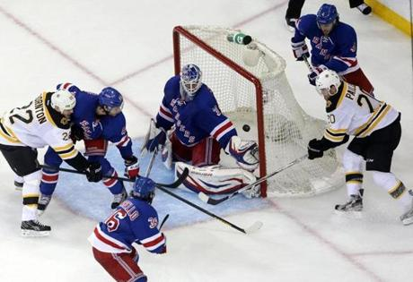 Boston Bruins left wing Daniel Paille (20) scored the game-winning goal as he batted the puck out of the air and bounced it behind New York Rangers goalie Henrik Lundqvist (30) and into the net in Game 3 of the Eastern Conference Semi Finals at Madison Square Garden.