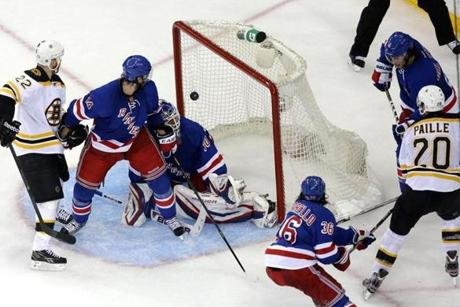 Daniel Paille watches as the puck he batted out of the air gets behind Rangers goalie Henrik Lundqvist and heads to the back of the net for the winner at 16:29 of the third period.