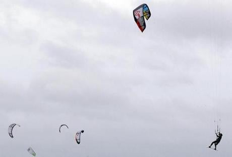 Dave Sullivan, 44, of Revere got air as he kite-surfed at Pleasure Bay in South Boston.