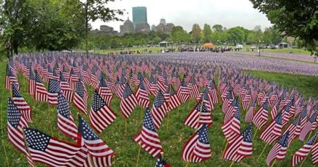 Nearly 33,000 flags filled the Boston Common near the Soldiers and Sailors Monument for Memorial Day to honor Massachusetts men and women who died in service to the country.