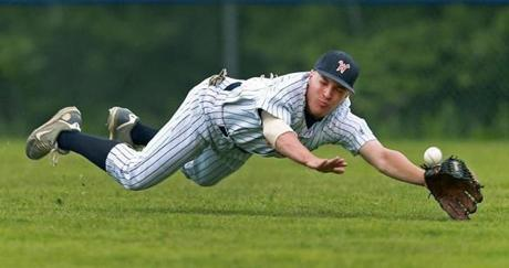 Walpole right fielder Matt Bender made a valiant effort but couldn't come up with the catch on a hit by a Braintree player during a high school varsity baseball game.