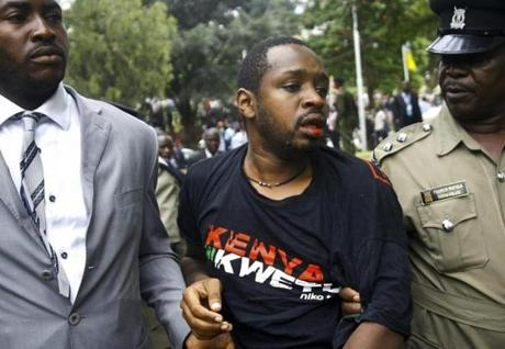 Kenyan activist Boniface Mwangi is arrested after trying to disrupt a speech during a Labor Day celebration in Nairobi on May 1.
