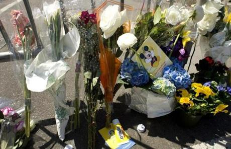 A tube of Bengay, a pain relief medecine, lays nears flowers at a memorial site at Boylston and Arlington streets.