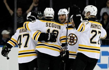 Torey Krug (from left), Tyler Seguin, Nathan Horton, and Dougie Hamilton celebrated after Krug's goal.