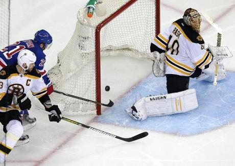 New York Rangers center Derek Stepan (21) beat Boston Bruins defenseman Zdeno Chara (33) and Boston Bruins goalie Tuukka Rask (40) with a wrap-around goal to tie the game at 2-2 in the third period of Game 4 of the Eastern Conference Semi Finals at Madison Square Garden in New York.