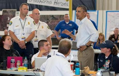President Barack Obama met with first responders during a tour of the devastation in Moore, Okla.