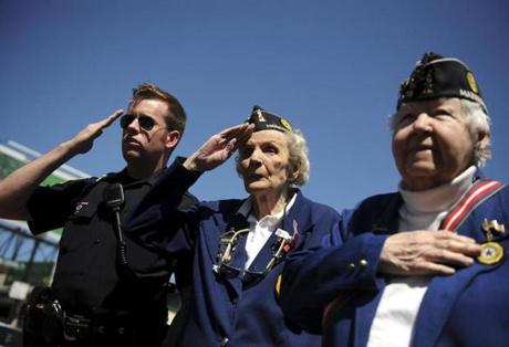 Boston police Officer Matt Haslett, Eleanor Havey, and Claire Paulie saluted during the playing of the National Anthem during Memorial Day activities at the Foggs-Roberts American Legion Post 78 in Hyde Park.
