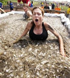 "A Tough Mudder competitor reacted to jumping into the bucket the company calls the ""Arctic Enema."""