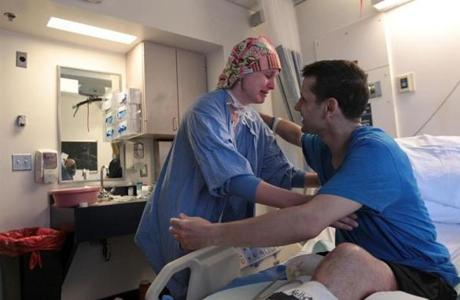 Amanda Heidbreder, a nurse anesthetist, hugged Marathon bombing victim Marc Fucarile in his room at Massachusetts General Hospital before he left for the Spaulding Rehabilitation Hospital.