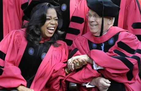 Oprah Winfrey clasped hands with Boston Mayor Thomas Menino prior to their receiving honorary degrees from Harvard at commencement ceremonies.