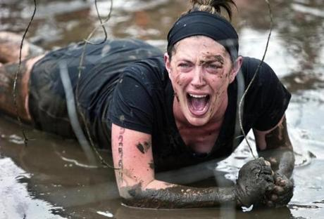 Cassie Wesch, a single mom from Tuscola, Ill., was midway through the Electric Eel, where dangling wires give off 10,000 volts of electric shocks, in the Tough Mudder Obstacle Course Challenge.
