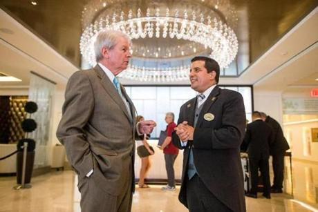 Denis (left) with Langham concierge David Canas.