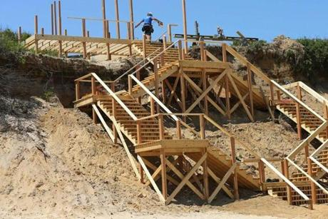A new staircase leading from a cliff to Nauset Light Beach in Eastham will open soon. The landscape has a very different look, said Ted Keon, town director of coastal resources.