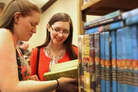 Sisters Megan and Lisa Crowley of Tewksbury browsed books at the convention.