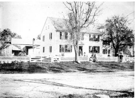 The Grout-Heard House in 1868 with members of the Grout and Heard families.