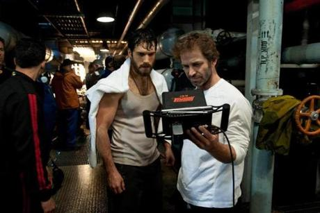 Cavill (left) with director Zack Snyder on the film's set.