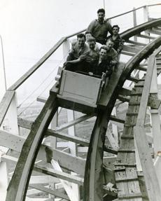 June 2, 1942: Mechanics who have just finished the annual inspection and repairs to the Paragon Park roller coaster gave it a tryout on the first ride of the 1942 season. Because of World War II and wartime blackout restrictions, blue cellophane had to be put over all the white lights on the park rides and the lights on Nantasket Avenue had to be painted black. All traffic had to be kept off the roads after dark for riders safety.