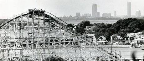 August 19, 1982: The Nantasket Roller coaster gave a good view of the Boston skyline in the distance. The giant coaster was built after the park fire in 1916 and opened for rides in May of 1917. It gave a ride of nearly a mile and a half, its highest point 98 feet above the ground. It cost $100,000 to build and 200 mechanics worked nine months on its construction.