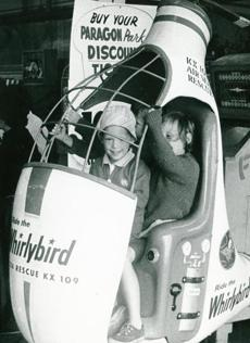 December 3, 1964: George Turpins, 4, and his sister Debra ,7, of North Grafton took a ride on the Whirlybird.