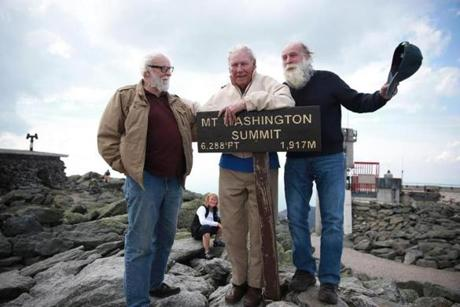 As Gosselin (from left), Addison, and Wright stood on the summit to pose for photos, the wind picked up, seemingly a reminder of how unpredictable the mountain can be.