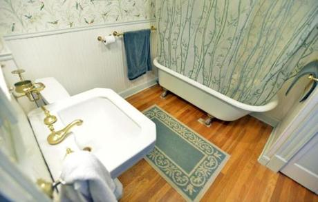 The family bath has a claw-foot tub and shower.