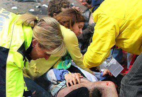 Amanda North (center) helped Erika Brannock after she was injured by the first blast at the Marathon finish line.