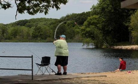 Frank Arena of Weymouth fished with his neice Zoie Burgess at the Sunset Lake recreation area.