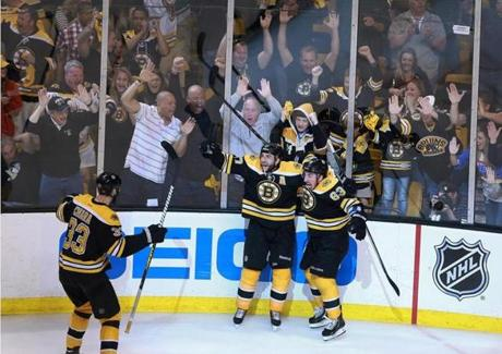 Bergeron then began the celebration with Brad Marchand (63) and Zdeno Chara (33) in the corner of the rink.