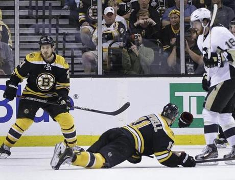 Bruin Gregory Campbell sprawls on the ice, absorbing the impact of an Evgeni Malkin slap shot during a Penguins power play in the second period on Wednesday night at TD Garden.