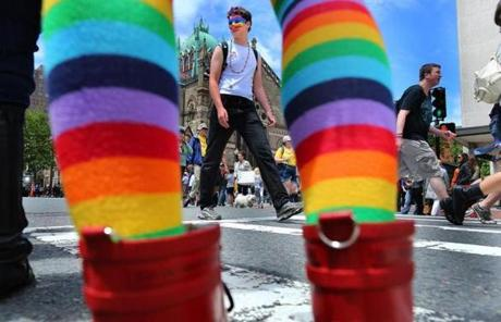 A woman's rainbow stockings framed marchers in the annual Boston Pride parade on Boylston Street in Copley Square.
