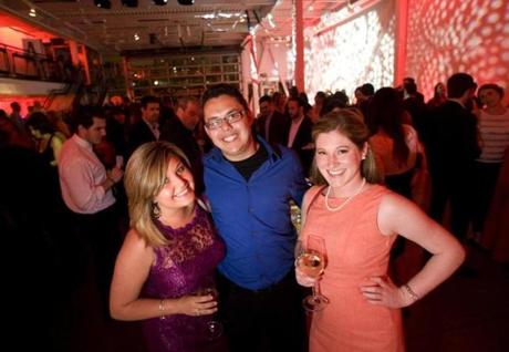From left: Ashley Haskell, Fernando DeOliveira, and Ariana Shaw, all of Boston. Friday, June 7, 2013 at the Young Professionals Committee of Big Brothers Big Sisters Casino Night at Artists for Humanity EpiCenter. Photo by Laurie Swope