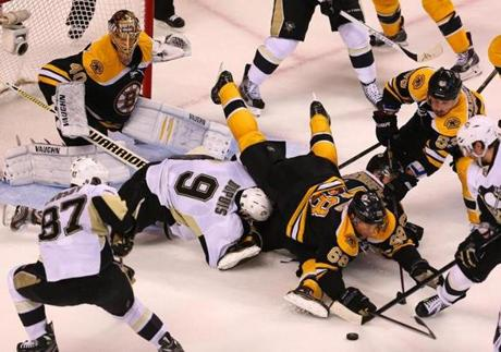 Bruins right winger Jaromir Jagr landed on the Penguins' Pascal Dupuis in front of goalie Tuuka Rask during the Eastern Conference Final game 4.