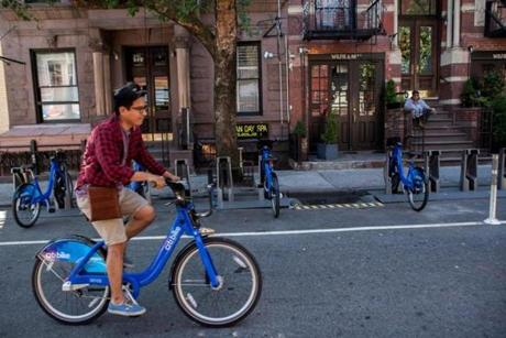 Jason Salvatierra rode a Citi Bike through Greenwich Village last week. The program, which launched in late May, is managed by the same firm that oversees Boston's Hubway.