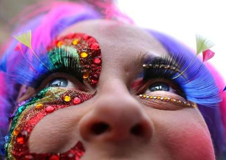 Leah Spivey of Tewksbury sported colorful eyelashes at the Boston gay pride parade, which had more than 15,000 marchers.