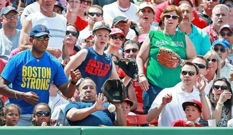 6/9/13: Boston MA: There were plenty of fans wearing gloves, but the man in the front row could't make the play on a foul ball hit his way. The Boston Red Sox hosted the Los Angeles Angels in a regular season MLB baseball game at Fenway Park.(Jim Davis/Globe Staff) section: sports topic:Angels-Sox (1)