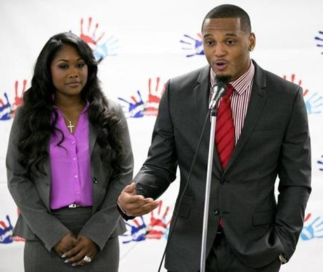 Boston, MA - 6/10/2013 - Patrick Chung spoke to a group of people and media at the Boston Chinatown Neighborhood Center with his wife Cecelia Chung (cq). NFL player Patrick Chung visited the Boston Chinatown Neighborhood Center to make a $25,000 donation to the Summer Music Academy for Real Teens (SMART) in Boston, MA on Monday, June 10, 2013. SMART is a three-week summer program sponsored by Chung Changing Lives, Inc. (Yoon S. Byun/Globe Staff) Slug: n/a Reporter: shanhan LOID: