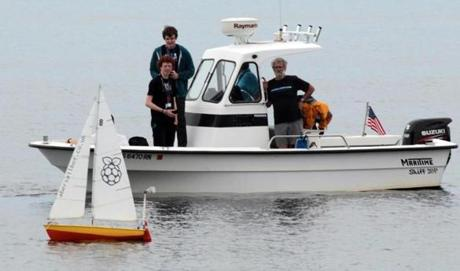 Members of the Endicott College team keep an eye on their boat and the competition  n Gloucester Harbor.