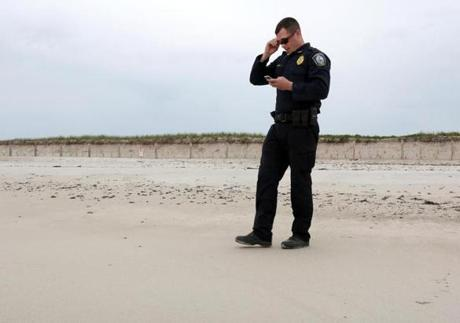 Mike Pforr, endangered species officer with Duxbury's Harbormaster Department, patrols along Duxbury Beach, where signs restrict access to piping plover nesting areas.