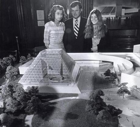 May 29 1973 / fromthearchive / Globe Staff photo by Joe Dennehy / Eunice Kennedy Shriver, Sen. Edward M. Kennedy and Caroline Kennedy look at the features of the proposed John F. Kennedy Library to be built on a 12.2 acre site to be vacated by the Massachusetts Bay Transportation Authority during the next year. A 75-foot-high glass pavilion designated as the museum portion of the library complex will tower above the the brick buildings planned for the library itself, the presidential archives, Harvard's John F. Kennedy School of Government and the Kennedy Institute of Politics.