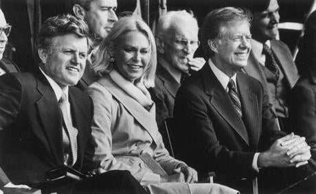 October 20, 1979:  Senator Edward M. Kennedy and his wife Joan were joined at the John F. Kennedy Library dedication by President Jimmy Carter. Former House Speaker John W. McCormack can be seen behind them. More than 7000 guests listened to the speeches and heard the Boston Pops lead by Harry Ellis Dickson, who began the musical program with Aaron Copland's