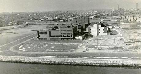 February 10, 1975: The University of Massachusetts invited the John F. Kennedy Library Corp. to consider locating its proposed library and museum on the university's Boston or Amherst campus. The offer was made after a decade-old plan to build the Kennedy museum in Cambridge was finally abandoned. The announcement made by university President Robert Wood made clear that the UMass proposition was only for both the museum and the library together. The eventual parcel of land used for the construction at the Boston campus of UMass is seen in this photo.