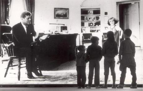 May 29, 1982: A group of children touring the Kennedy library during a celebration for the President's 65th birthday stopped in front of a huge mural of JFK in the Oval Office where he was shown with daughter Caroline.