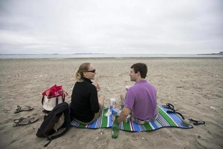 Kasia Hayden and Steve Liss of Cambridge enjoyed a picnic on Revere Beach. With rain in the weather forecast, they were virtually alone on the beach.